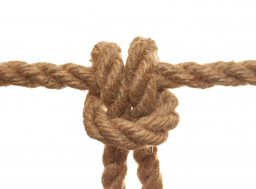Rope knot isolated on a white background as a strong nautical marine line