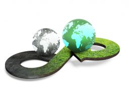 69437753 - circular economy concept. arrow infinity symbol with grass texture and two globes of different colors, isolated on white background, 3d rendering.